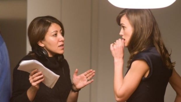 Writer/director Massy Tadjedin with Keira Knightley on the set of Last Night.