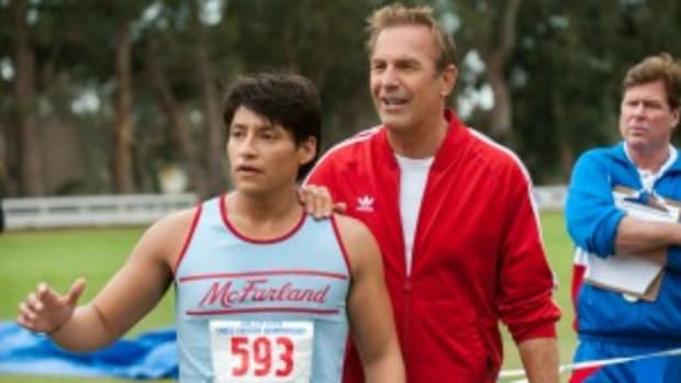 Coach Jim White (Kevin Costner) and Thomas Valles (Carlos Pratts) share a moment of triumph in a triumphant film.