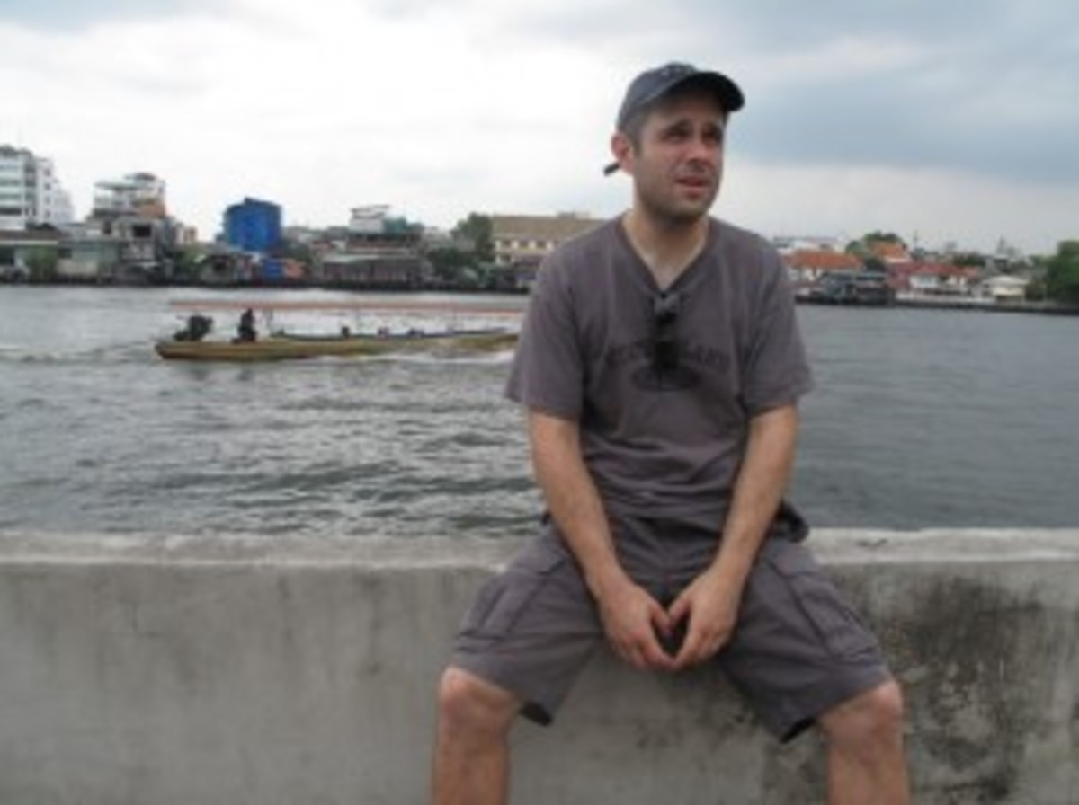 Craig Mazin sitting on the banks of the Chao Praya River in Bangkok during filming of The Hangover Part II