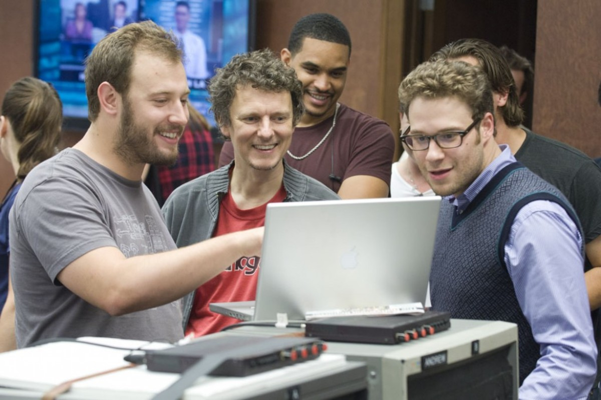 Screenwriter Evan Goldberg, left, talks with director Michel Gondry and Seth Rogen on the set The Green Hornet.