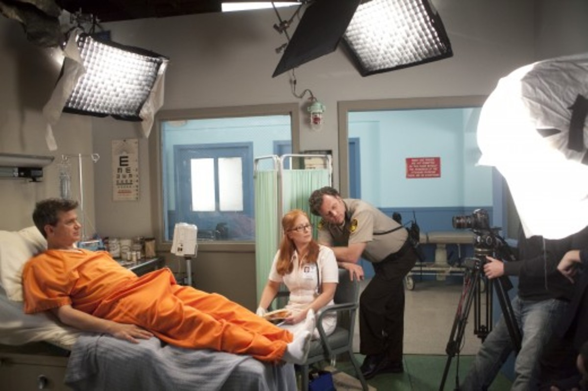 "Co-creator John Lehr (in orange jumpsuit) on the set of ""Jailbait."""