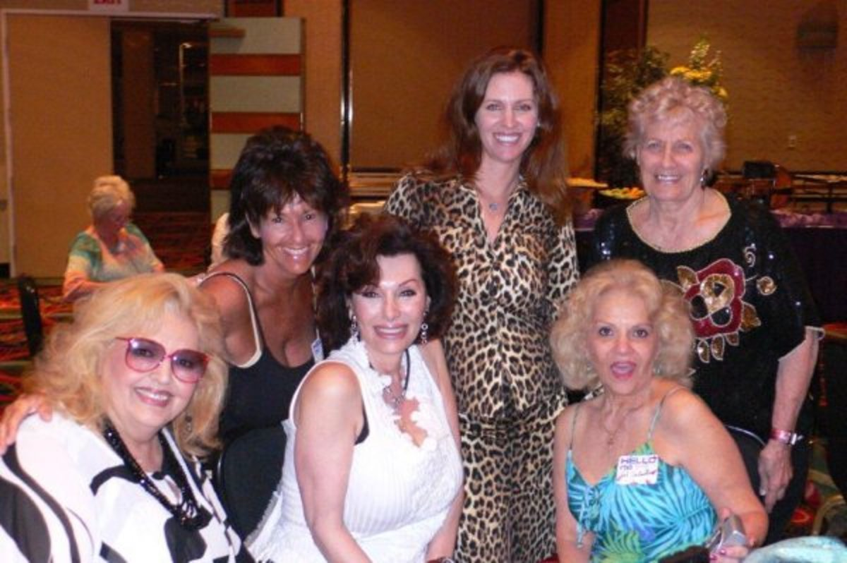 Leslie Zemeckis (center in animal print) and a group of former Burlesque stars.