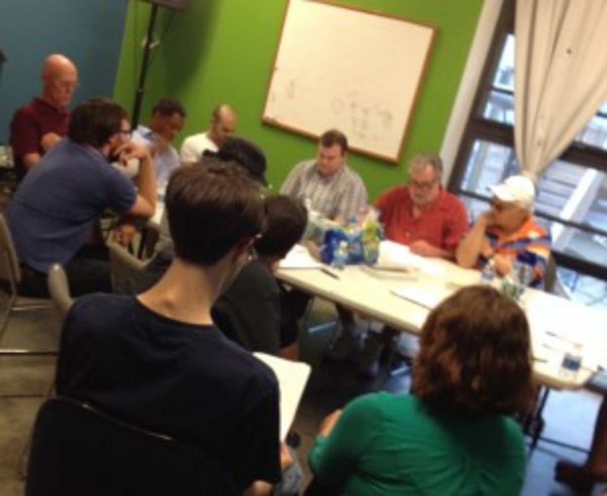 The Baltimore Screenwriters Coffee Club discussing their work at monthly meeting.