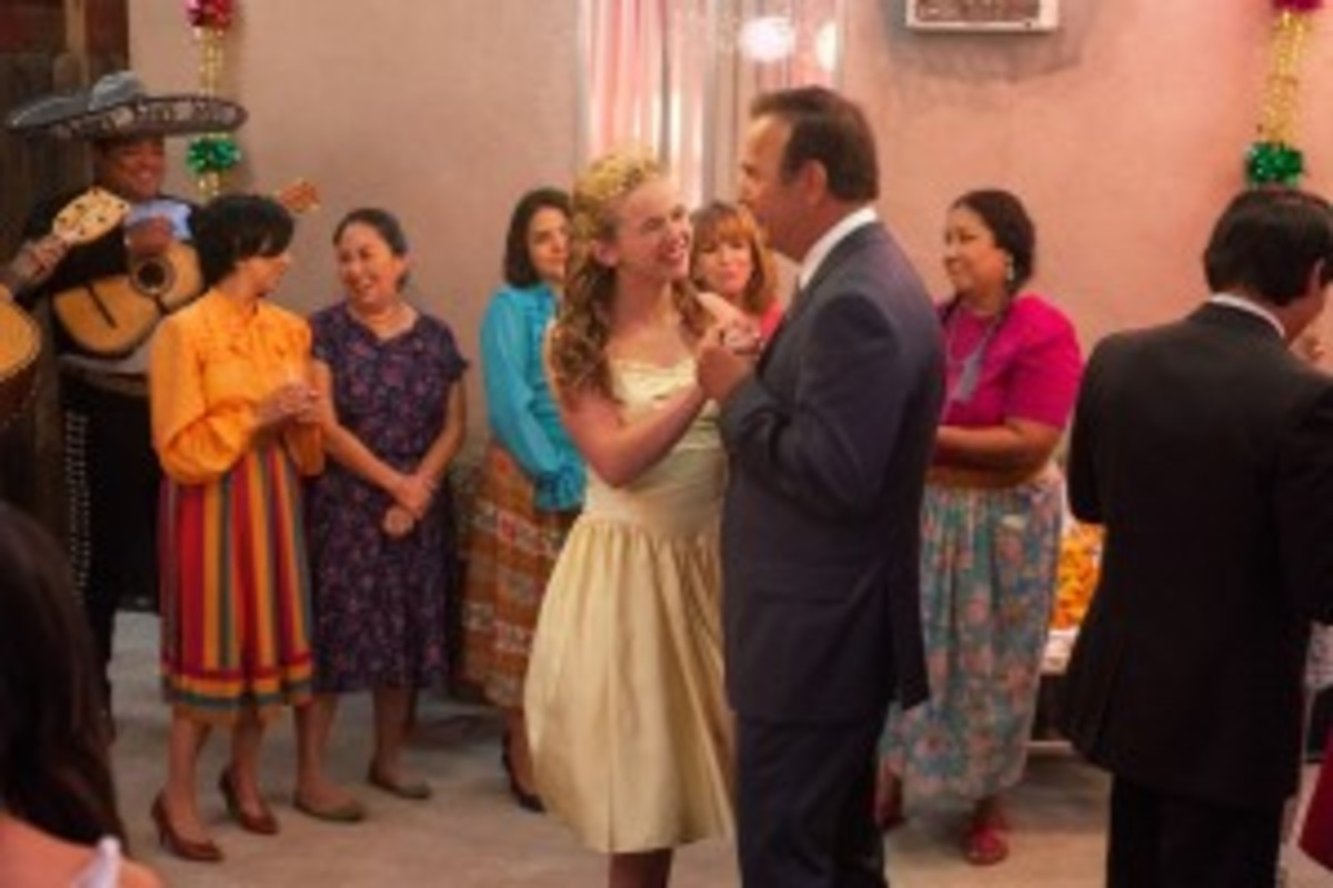 Coach White and his daughter dance during her quinceañera. The strong bonds that form between White's family and the people of McFarland are threatened by White's plans to ditch the place for a better job.