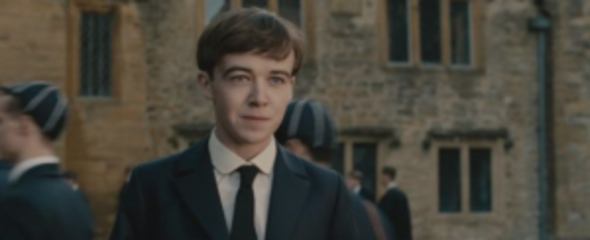 A young Alan Turing (Alex Lawther). The basic question for screenwriters: is it worth the valuable screen time to dramatize expository information through flashbacks?