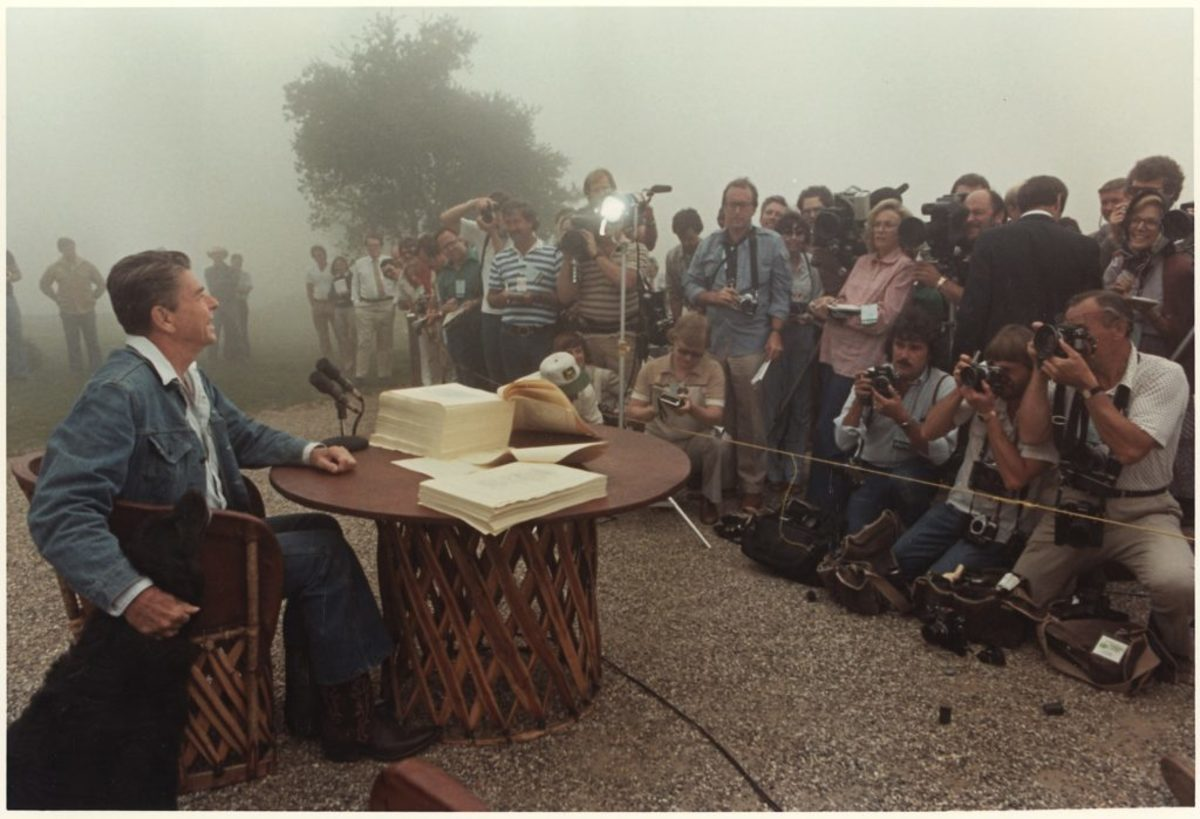 President Ronald Reagan signs the Economic Recovery Tax Act of 1981, Rancho del Cielo, CA, 1981. Photo credit: Karl Schumacher. Photo courtesy of the Ronald Reagan Presidential Library. (Gravitas Ventures & CNN Films)