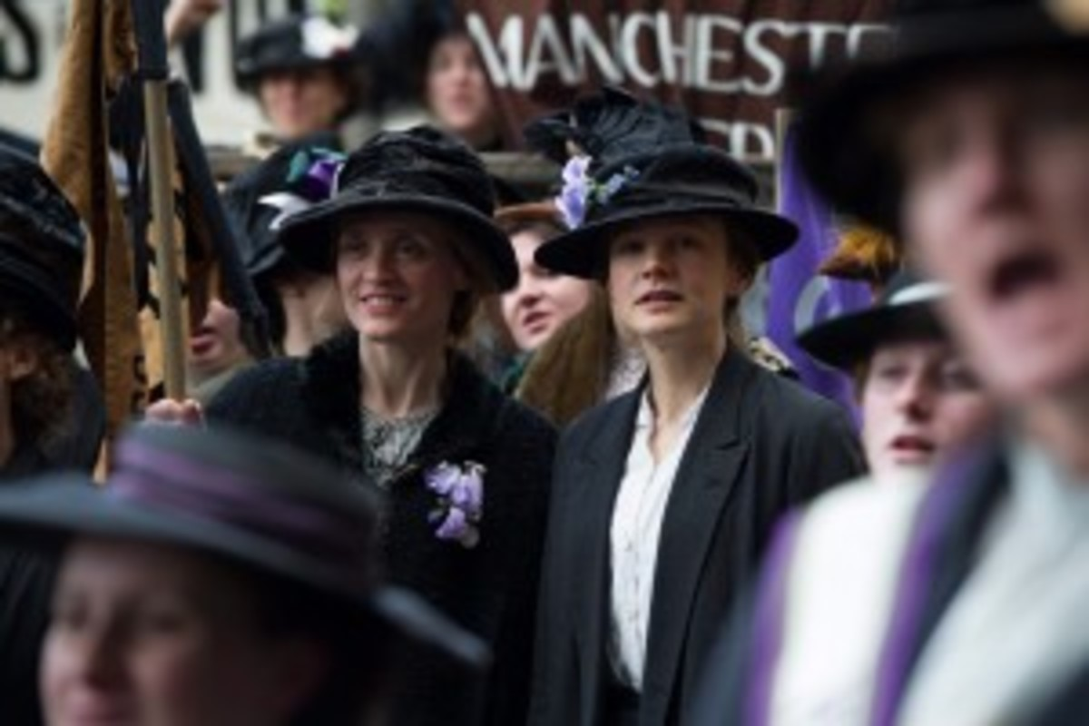 (l-r.) Violet Miller (Anne-Marie Duff) and Maud Watts (Carey Mulligan) campaign for women's voting rights in director Sarah Gavron's SUFFRAGETTE, a Focus Features release. Credit: Steffan Hill / Focus Features