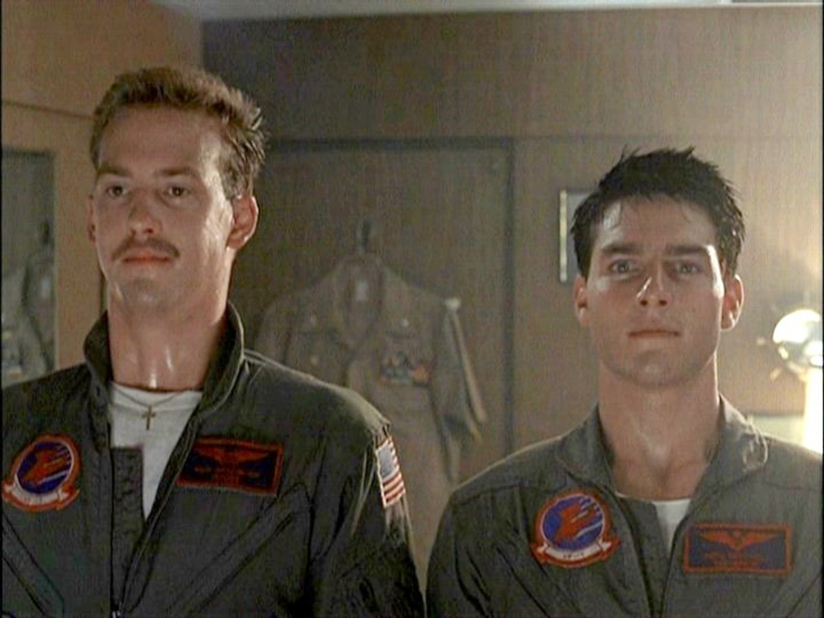 Often in clothes and positions that seem to reflect one another by design, Goose is a lot more than just a sidekick in Top Gun.