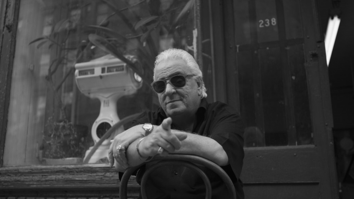 Vinny Vella sits in front of Mo's the butcher on Elizabeth Street in Little Italy. From the short film MULBERRY. Photo Credit: Paul Stone