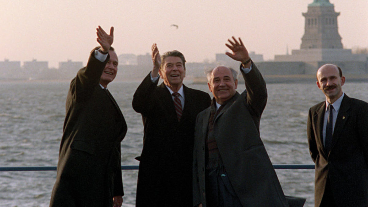 George Bush, Ronald Reagan, and Mikhail Gorbachev all wave to the press corps. Film still from THE REAGAN SHOW. Photo credit: Ronald Reagan Presidential Library.