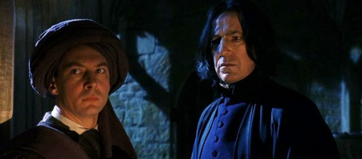 When Harry interrupts Snape and Quirrell arguing in shadows, most assume it's Snape up to something nefarious.