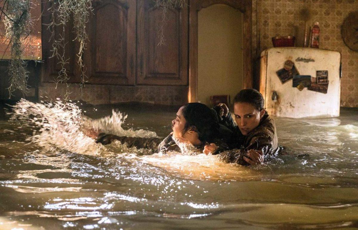 """Natalie Portman (far right) comes to Tessa Thompson's aid in """"Annihilation."""""""