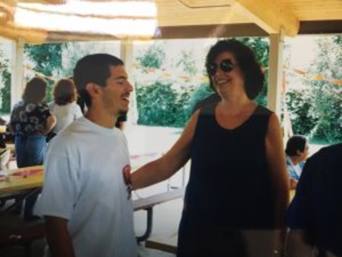 Me with Mrs. Morris at my high school graduation party.