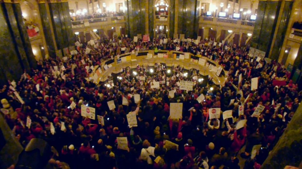 Protesters fill the rotunda in the Wisconsin State Capital in the run up to Gov. Walker's anti-union bill in a scene from CITIZEN KOCH