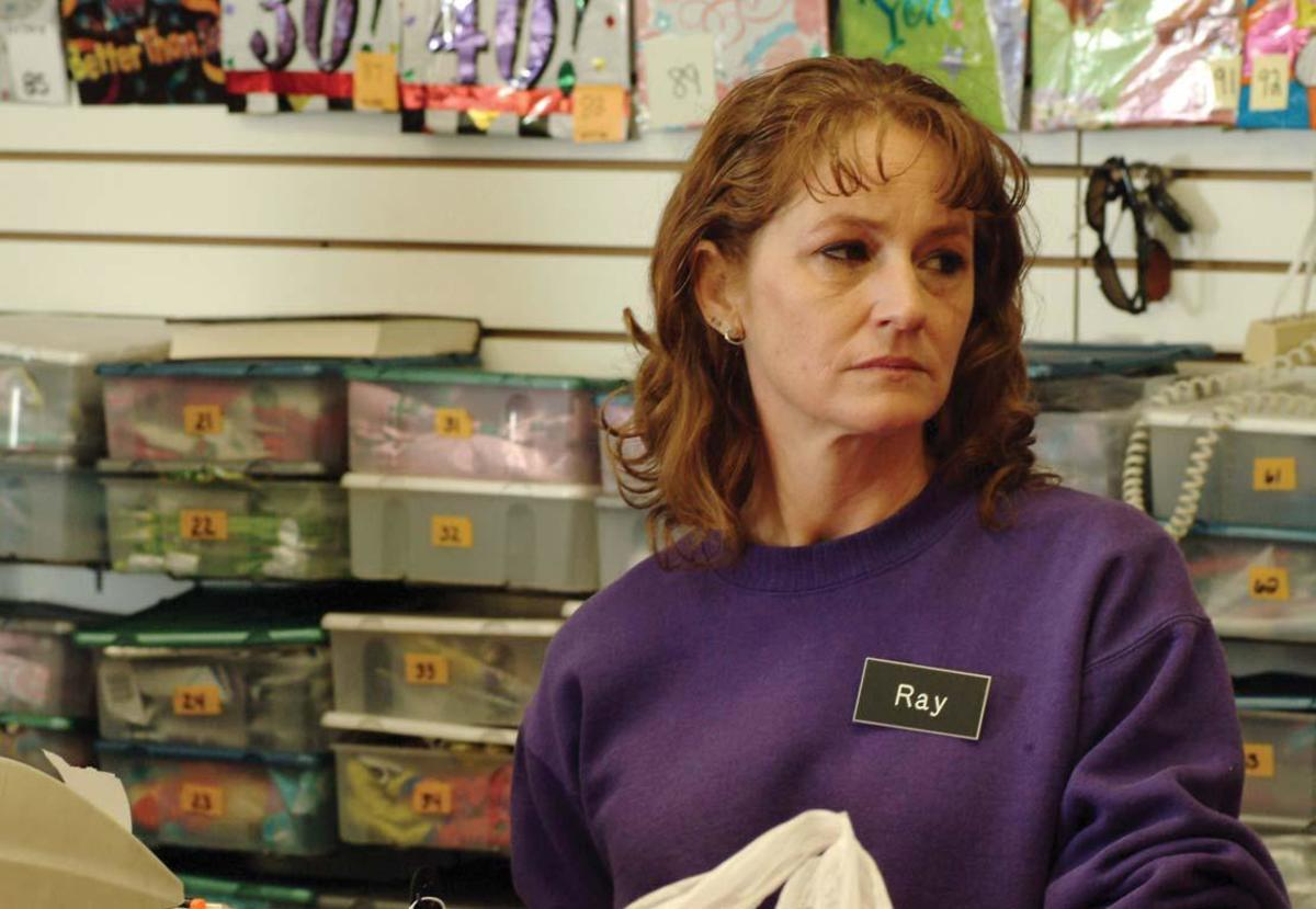 Ray bides her time working at a dollar store