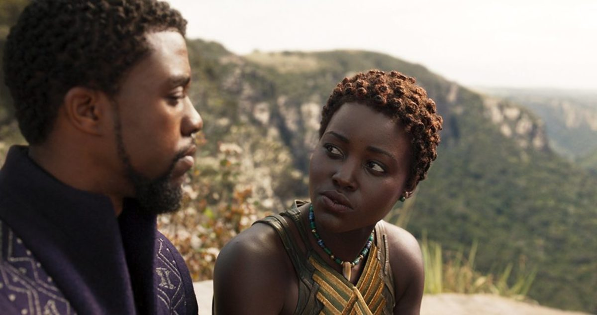 """T'Challa, Wakanda's heroic king (Chadwick Boseman), doesn't freeze in battle. But he's rattled around former love Nakia (Lupita Nyong'o) in """"Black Panther."""" (Credit: Marvel Studios)"""