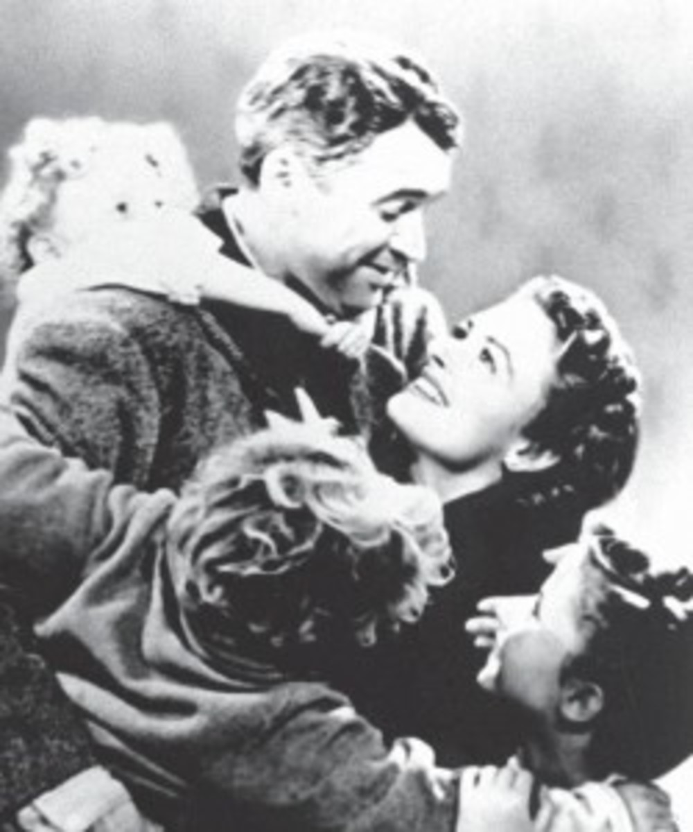"George Bailey (Jimmy Stewart) returns home to his family after a journey of self-discovery in It's a Wonderful Life, written by Philip Van Doren Stern (story, ""The Greatest Gift""), Frances Goodrich & Albert Hackett and Frank Capra, Jo Swerling (additional scenes)."