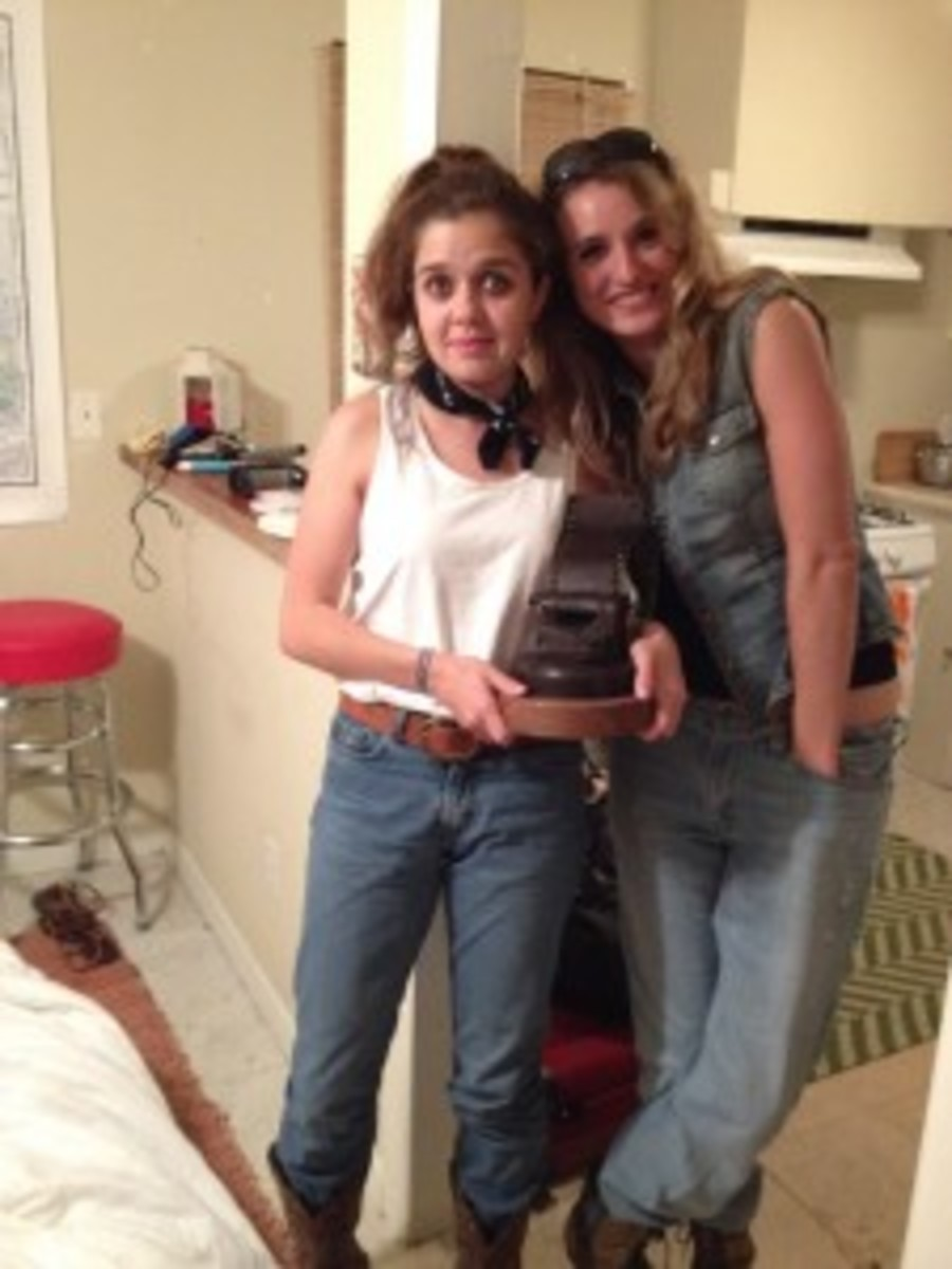 Us dressed as Thelma and Louise for the closing night Halloween costume party. With the golden typewriter award!