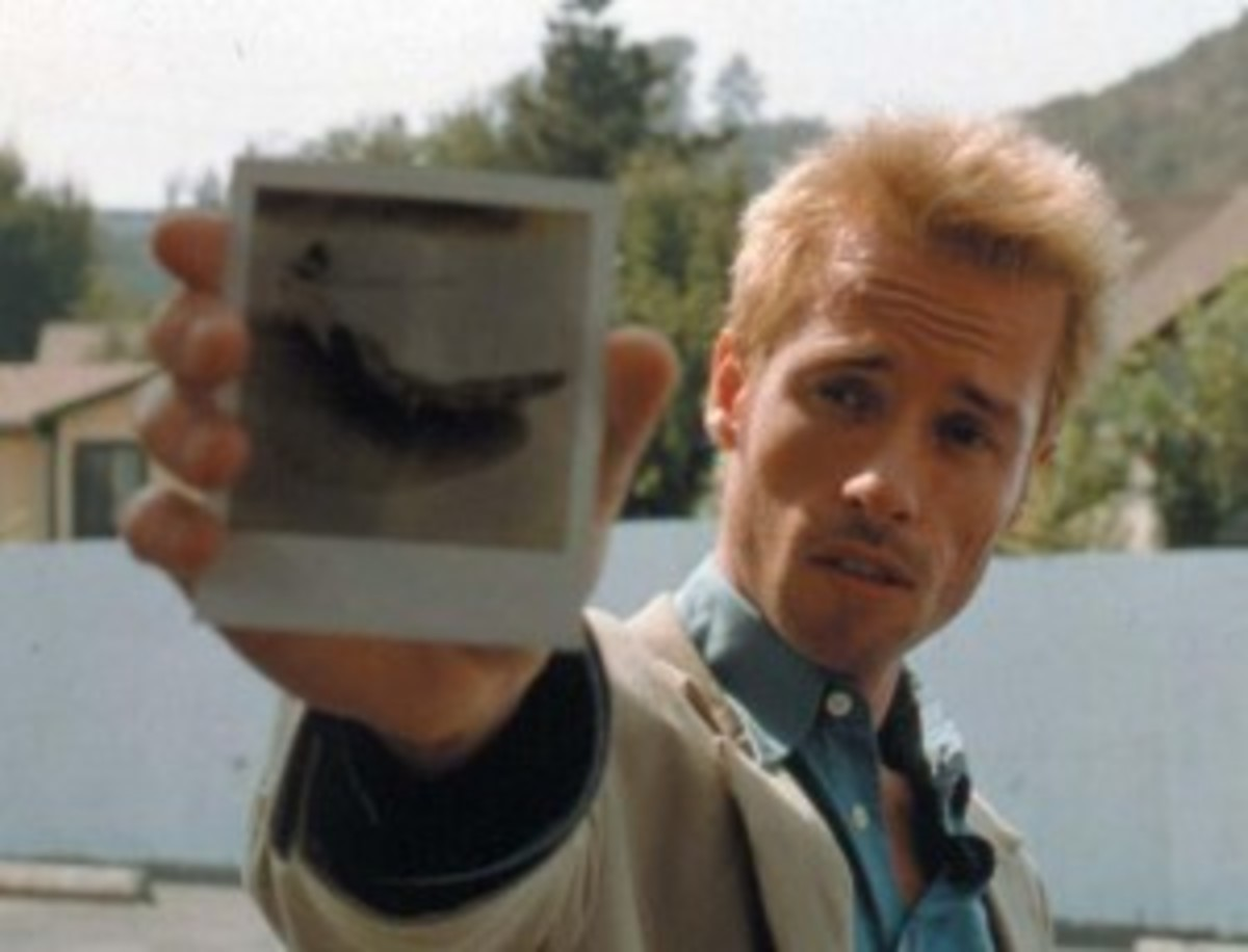 Guy Pearce as Leonard Shelby in Memento, written by Christopher Nolan and Jonathan Nolan (story). Photo Credit: Danny Rothenberg