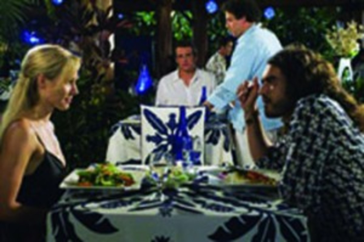 Kristen Bell, Jason Segel (background), and Russell Brand in Forgetting Sarah Marshall (Photo: Universal Pictures)