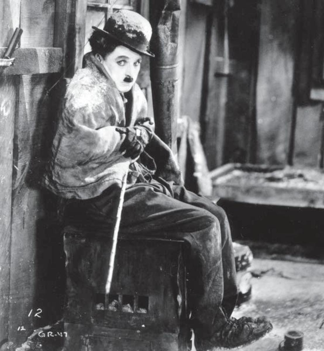 Charlie Chaplin as The Lone Prospector in The Gold Rush, written by Charlie Chaplin.