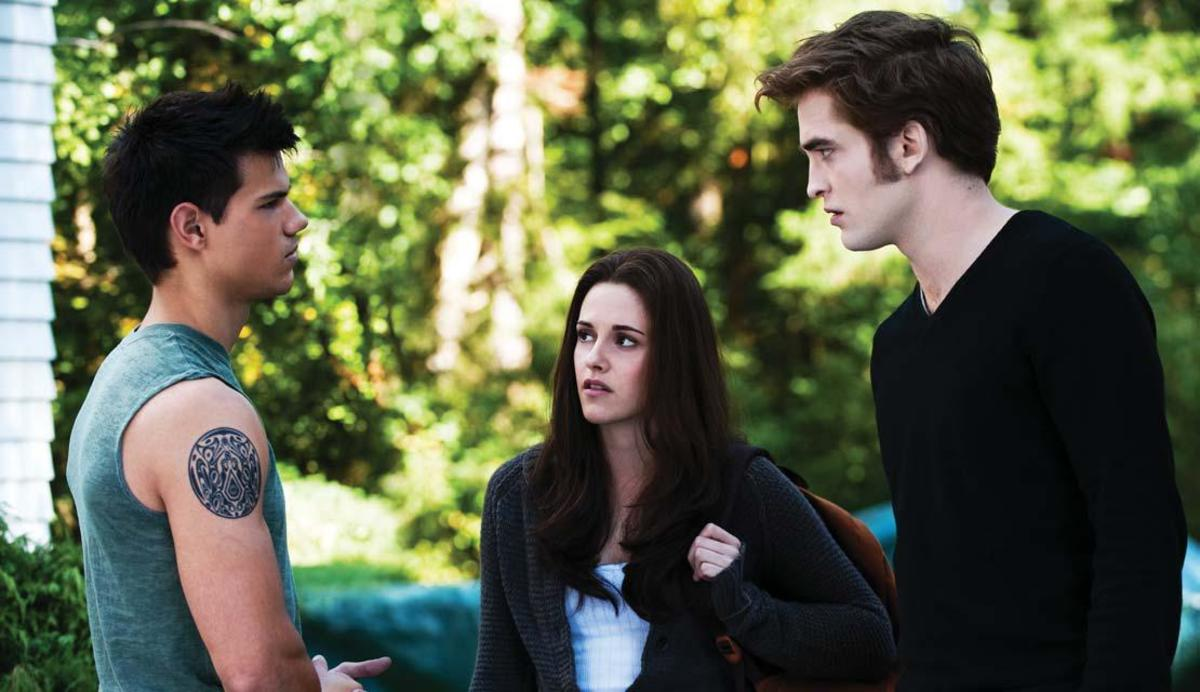 Left to right: Taylor Lautner as Jacob, Kristen Stewart as Bella, and Robert Pattinson as Edward in The Twilight Saga: Eclipse PHOTO: KIMBERLEY FRENCH COURTESY : SUMMIT ENTERTAINMENT