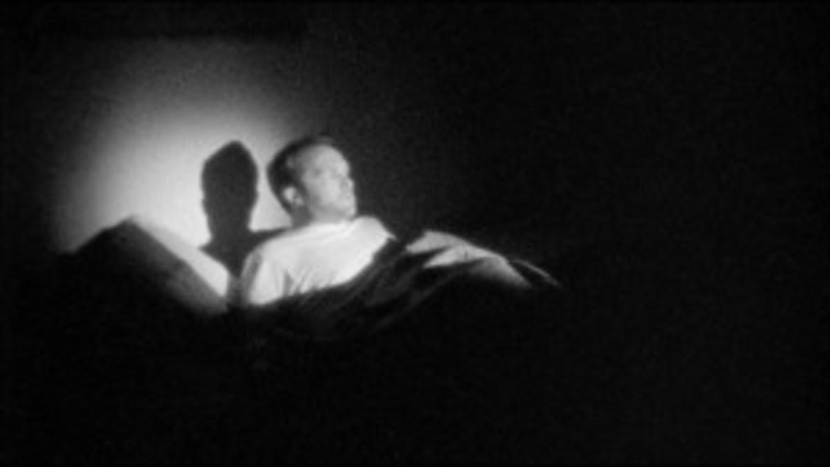 Frame grab from Wavelength: Adam is awoken by a blinding light.