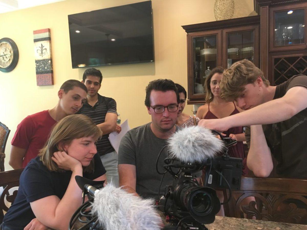 Ralko, center, previews footage