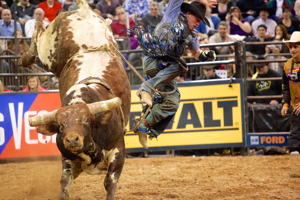 In Round 3 of the Professional Bull Riders Monster Energy Invitational at Madison Square Garden in New York, DAKOTA BECK leaps free of the bull after his ride. © Staton Rabin 2014