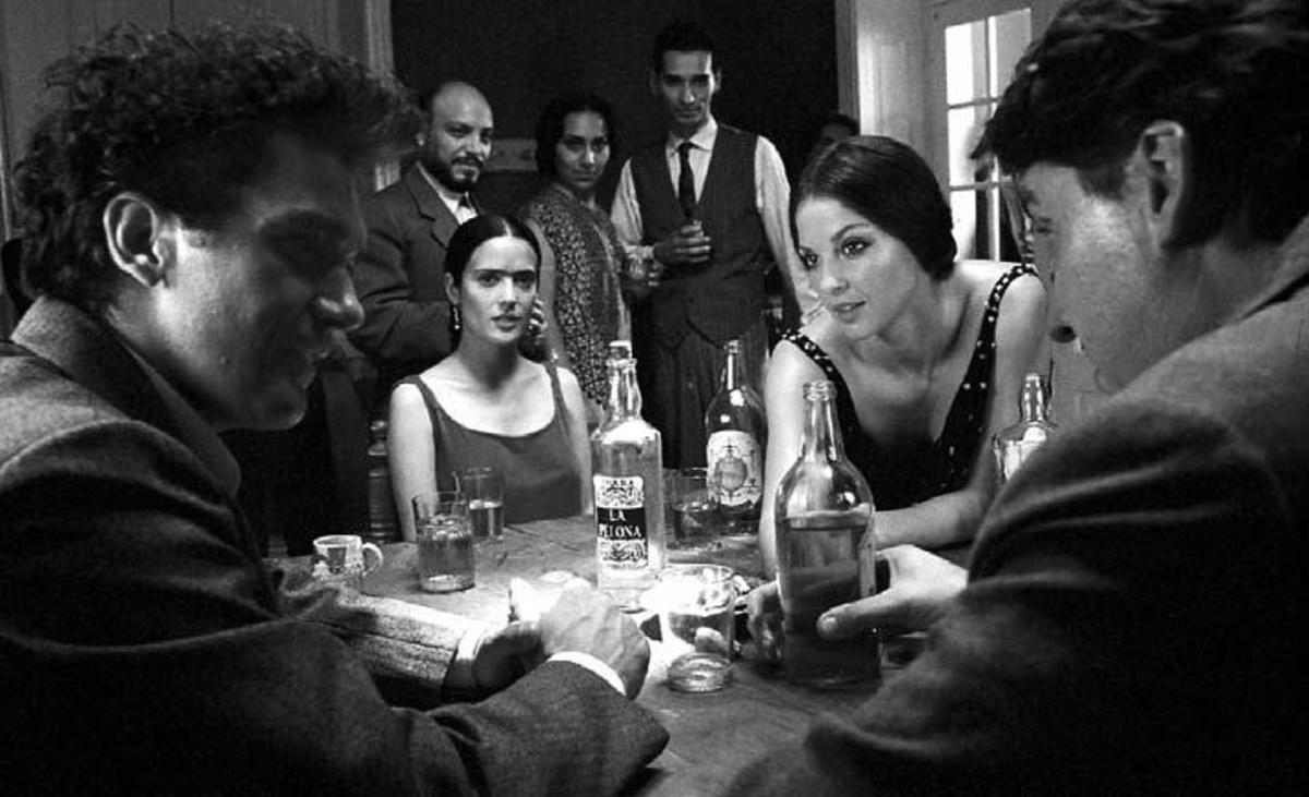 (From left to right seated at table) Antonio Banderas, Salma Hayek, Ashley Judd and Alfred Molina in Frida, written by Diane Lake