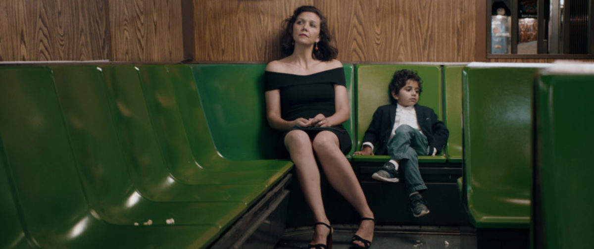 Maggie Gyllenhaal as Lisa, and Parker Sevak as Jimmy, on the subway on THE KINDERGARTEN TEACHER, Courtesy of Netflix, ©2018