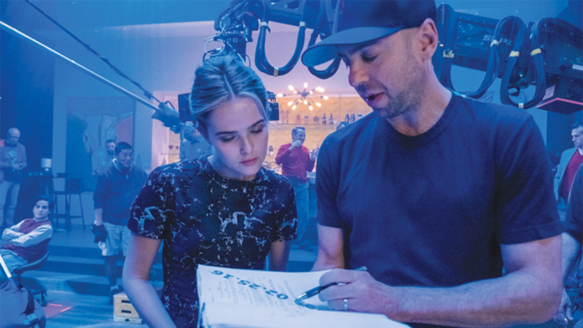 """Why Him?"" star Zoey Deutch consults with Hamburg on set for the Fox holiday release starring Bryan Cranston and James Franco. COURTESY OF 20TH CENTURY FOX"