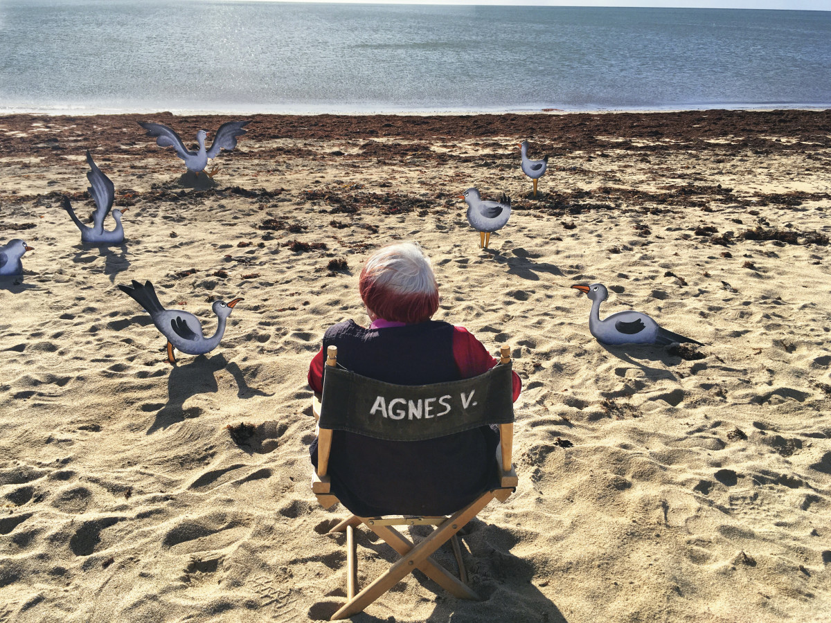 Agnès Varda on the beach with birds in VARDA BY AGNÈS - Courtesy Janus Films