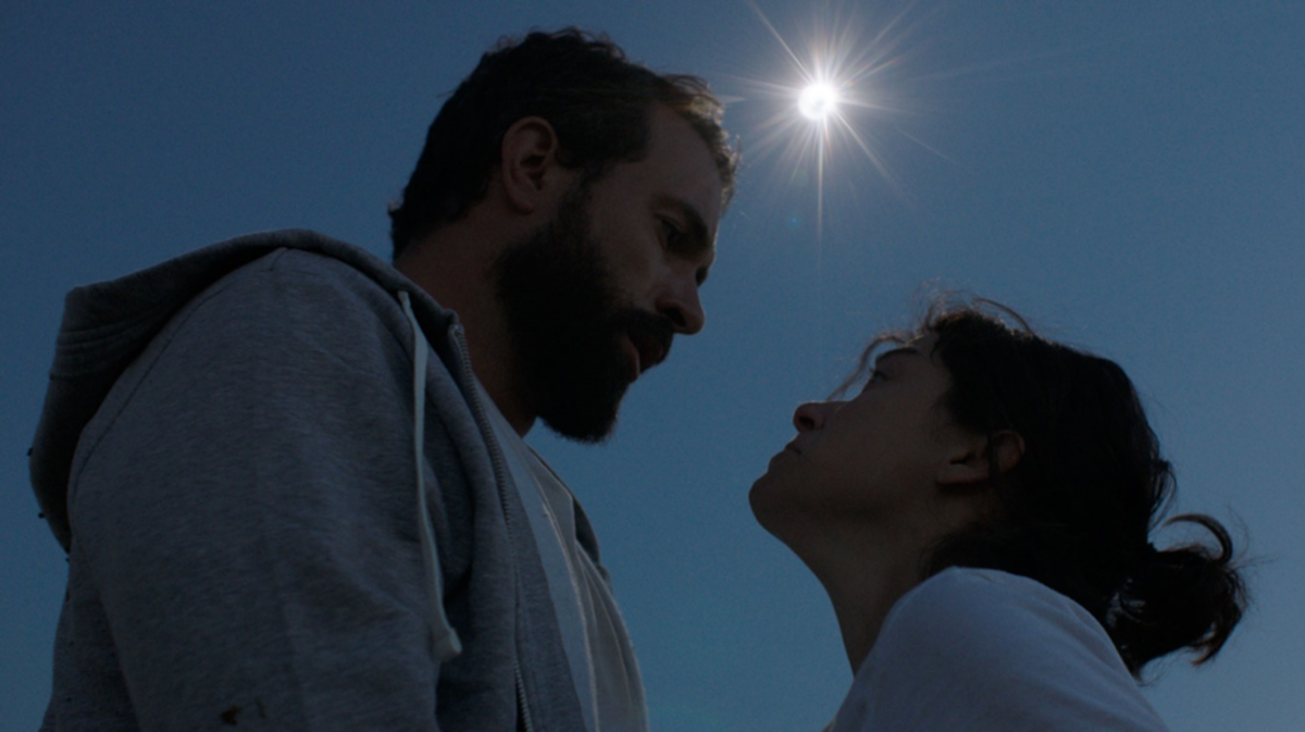 "Tom Cullen & Tatiana Maslany in ""Souls of Totality"" during a real-time solar eclipse"