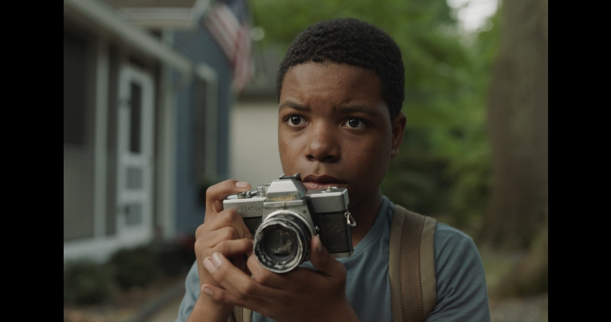 Leroy (Elijah M. Cooper) discovering his passion for photography