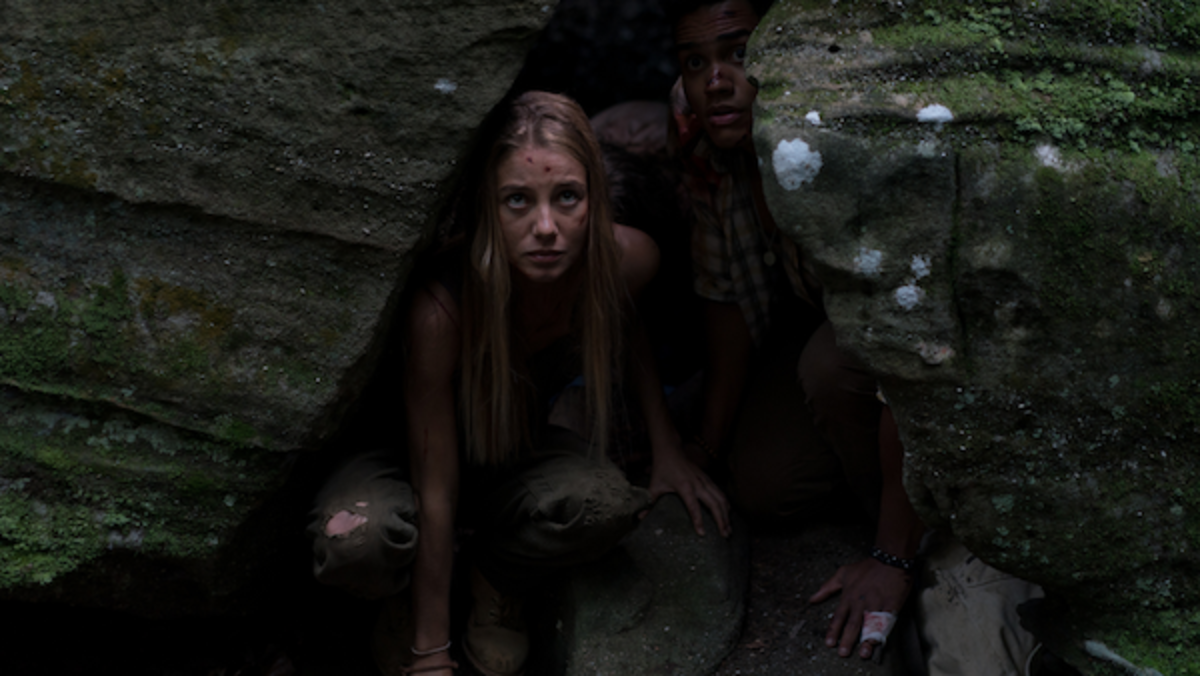 (L-R) Charlotte Vega as Jen and Adain Bradley as Darius in the horror film, WRONG TURN, a Saban Films release. Photo courtesy of Saban Films.