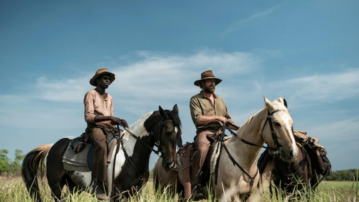 [L-R] Jacob Junior Nayinggul as Gutjuk and Simon Baker as Travis in the adventure/drama film, HIGH GROUND, a Samuel Goldwyn Films release. Photo Courtesy of Samuel Goldwyn Films.