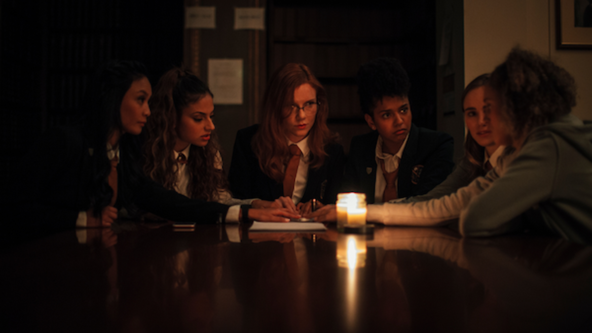 [L-R] Stephanie Sy as Yvonne, Inanna Sarkis as Alice, Madisen Beaty as Bethany, Djouliet Amara as Rosalind, Suki Waterhouse as Camille, and Ella-Rae Smith as Helina in the horror SEANCE, an RLJE Films and Shudder release. Photo courtesy of RLJE Films and Shudder.
