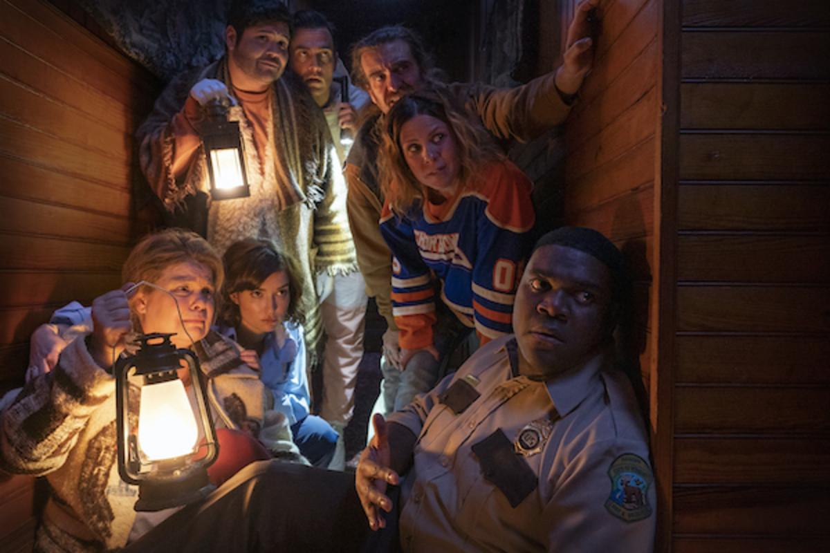 "(Left to right) Catherine Curtin as ""Jeanine Sherman,"" Milana Vayntrub as ""Cecily Moore,"" Harvey Guillen as ""Joachim Wolfson,"" Cheyenne Jackson as ""Devon Wolfson,"" George Basil as ""Marcus,"" Sarah Burns as ""Gwen,"" and Sam Richardson as ""Finn Wheeler"" Josh Ruben's WEREWOLVES WITHIN.Courtesy of Sabrina Lantos. WEREWOLVES WITHIN is an IFC Films Release."
