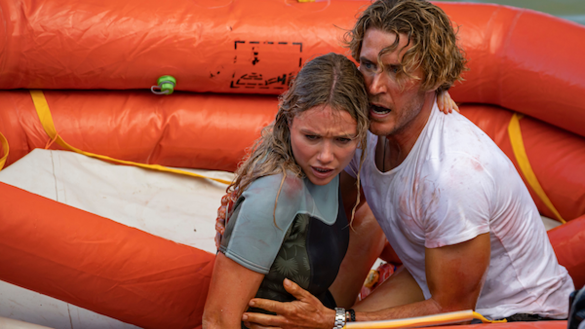 (L-R) Katrina Bowden as Kaz and Aaron Jakubenko as Charlie in the action-adventure/thriller, GREAT WHITE, an RLJE Films and Shudder release. Photo courtesy of RLJE Films and Shudder.