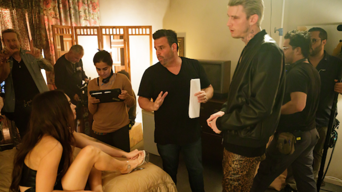 (L-R) Megan Fox, Director Randall Emmett, and Colson Baker (Machine Gun Kelly) on the set of the thriller film, MIDNIGHT IN THE SWITCHGRASS, a Lionsgate release. Photo courtesy of Lionsgate.