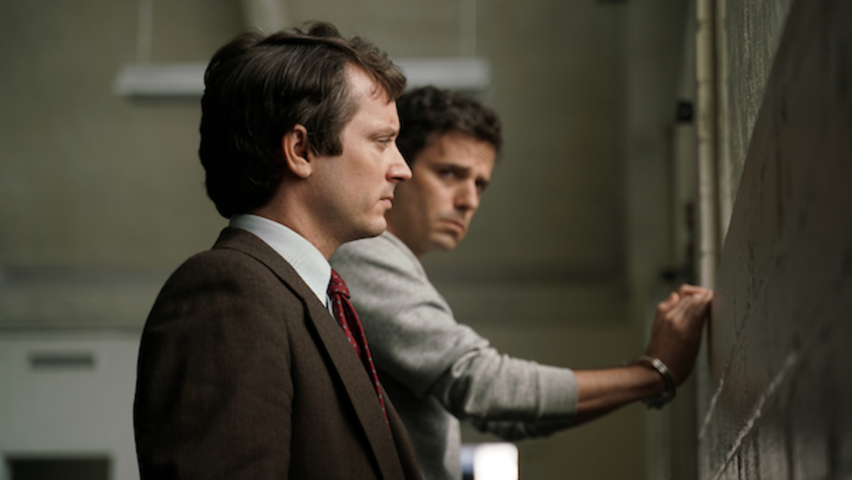 Elijah Wood as Bill Hagmaier and Luke Kirby as Ted Bundy in the drama/thriller, NO MAN OF GOD, an RLJE Films release. Photo courtesy of RLJE Films.